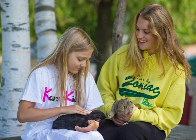 Girls with bunnies at TheZone camp sponsored by Kars4kids